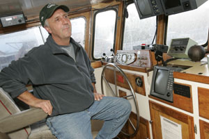 "Skipper Carroll Johnson says there can be a ""real glory"" to the fishing life. Photo by Michael Maloney, S.F. Chronicle."