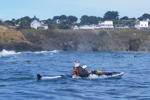 Paddling home – Paul McHugh rounding the Mendocino Headlands. Photo by John Weed.