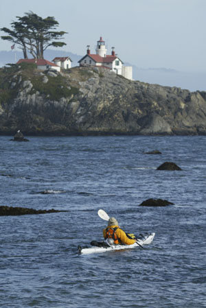 Paddling around the Battery Point light to enter the harbor. Photo by Michael Maloney, S.F. Chronicle