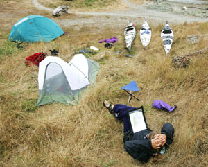 Relaxing in camp on Whaler Island. Photo by Michael Maloney, S.F. Chronicle