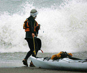 Paul McHugh selecting a moment to launch from Hidden Beach. Photo by Michael Maloney, SF Chronicle