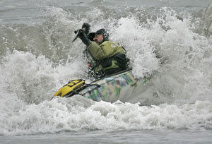 John Weed riding in to land on the north spit of the Eel River. Photo by Michael Maloney, S.F. Chronicle.