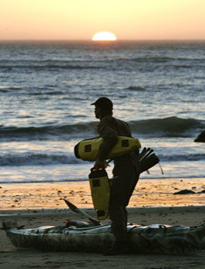 Gaining refuge just before sunset. John Weed unloads his kayak. Photo by Michael Maloney, S.F. Chronicle.