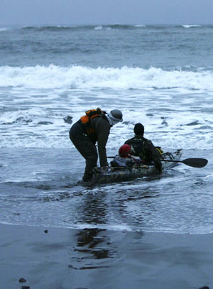 Paul McHugh helps John Weed launch one of their heavily-laden kayaks. Photo by Michael Maloney, S.F. Chronicle.