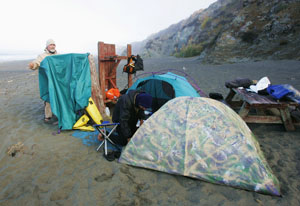 Drying gear at dawn before packing up to launch. Photo by Michael Maloney, S.F. Chronicle.