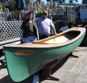 Stan (left) and Dusty, and one of their traditional small boats. Photo by Michael Maloney, S. F. Chronicle.