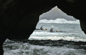 Weed and McHugh paddle away from the Mendocino Headlands through surging seas. Photo by Michael Maloney, S.F. Chronicle.