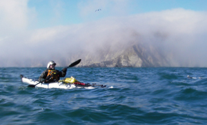 Paul McHugh paddles in heavy fog off the west shore of Point Reyes. Photo by John Weed.