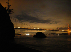 Jewel box – night lights of a famed bridge, and the San Francisco skyline. Photo by John Weed.