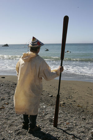 Stephen Littlebear, in traditional Aleut paddling garb, waits to extend a welcome. Photo by Michael Maloney, S.F. Chronicle.