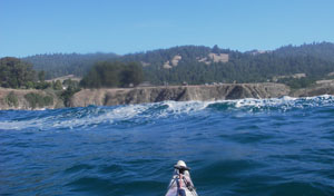 On a sea approach to Fort Ross; the protection of Sandy Cove lies just to the right. Photo by John Weed.