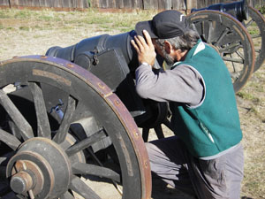 Assistant artilleryman first-class, John Weed, performs a risky cannon inspection. Photo by Dawn Garcia.