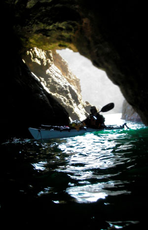 Paul McHugh explores the sea caves at Cuffy's Inlet. Photo by John Weed.